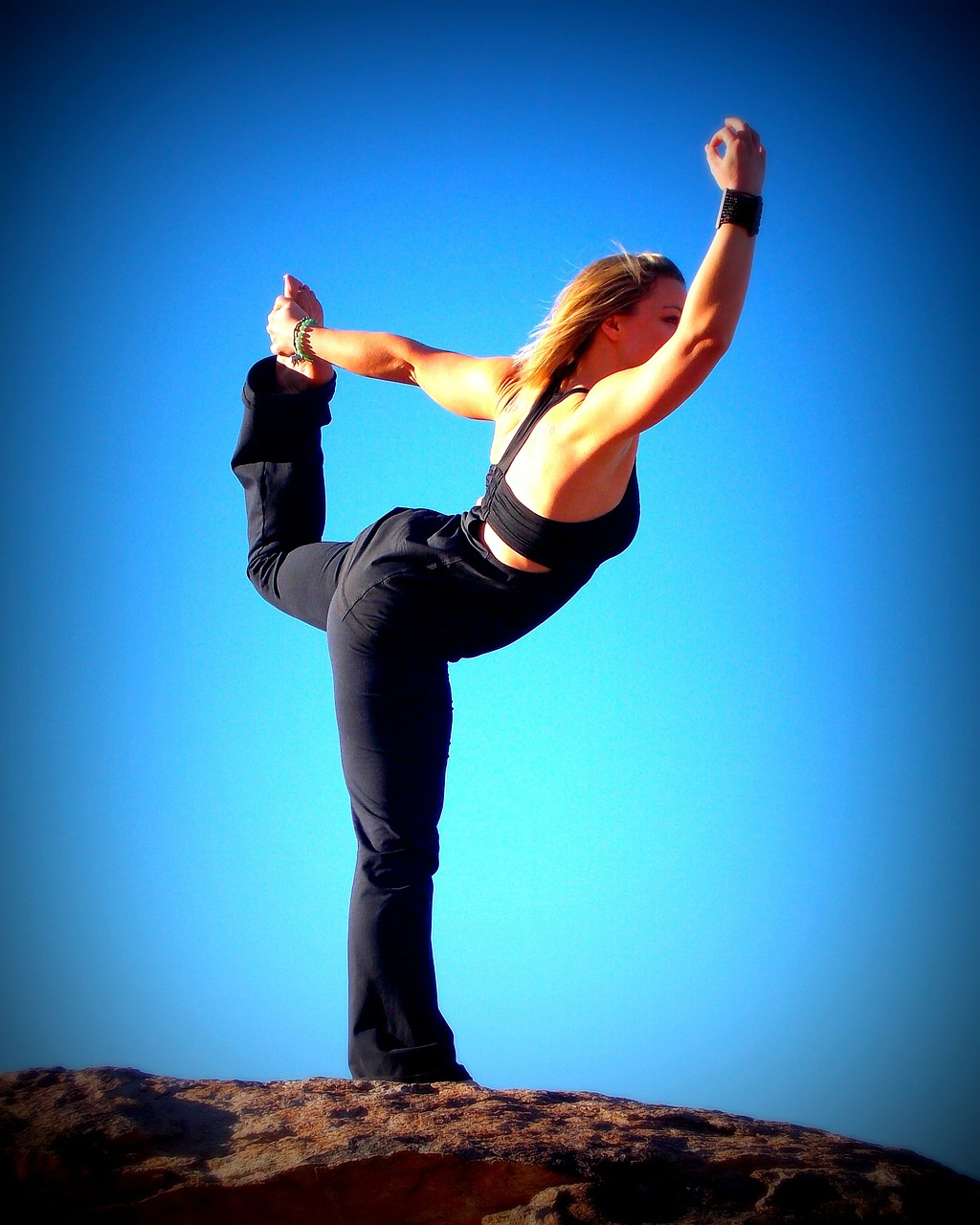 woman balance pose on rock